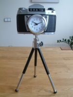 Nostalgic Clock in old camera body with tripod